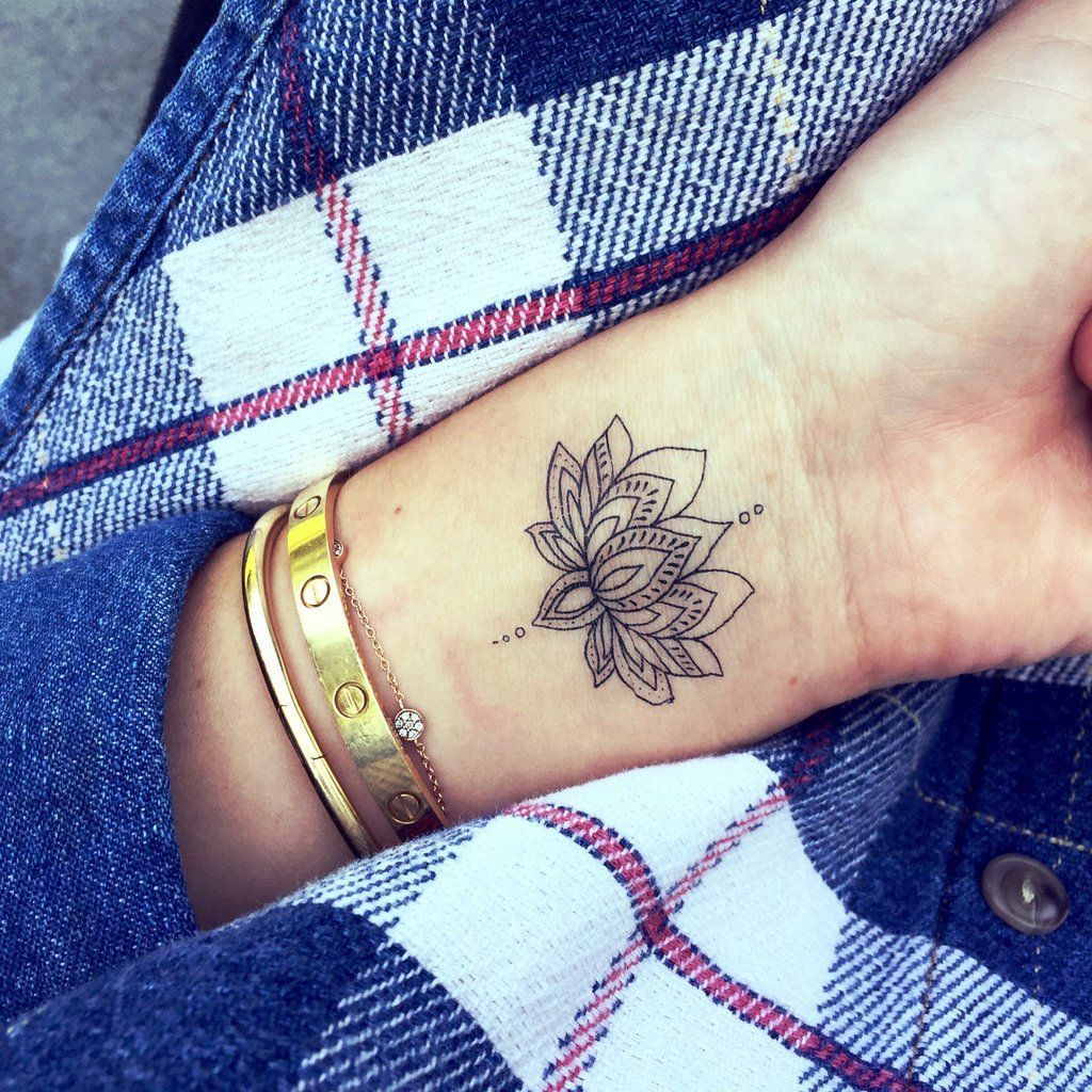 Pin by cullen on arte en la piel pinterest tattoos flower simple yet highly detailed wrist tattoo of a blooming flower petals open in a similar manner to a lotus or hibiscus with delicate dots on the top and izmirmasajfo