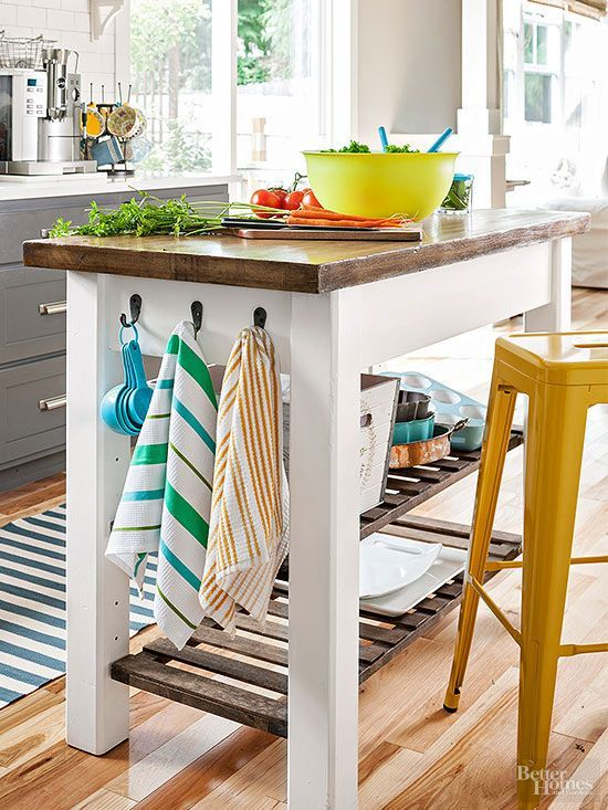 An unfinished piece of furniture became a personality-packed island thanks to a special DIY paint treatment. The homeowner used a plastic bag full of screws and nails to give the island a distressed texture. She then painted the frame, stained the top and shelves, and screwed in hooks to supply a handy spot for dish towels and utensils./
