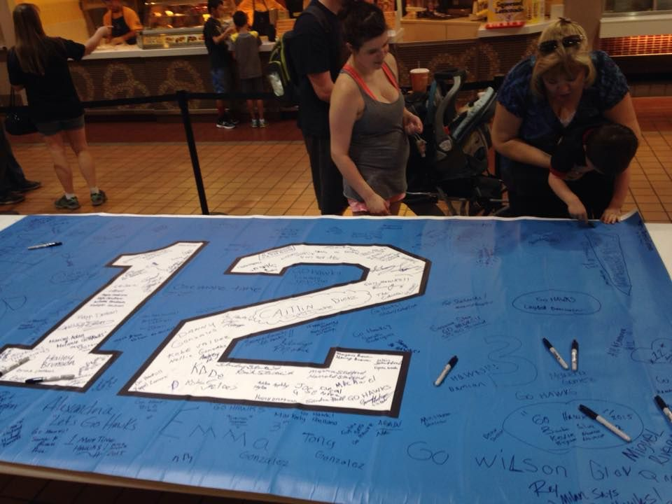Seahawks Fans Sign Flag to Kick Off Another Season