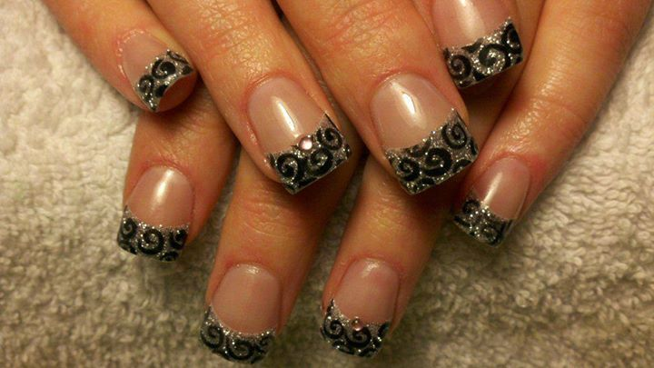 Silver glitter acrylic nail tips with black swirl nail art
