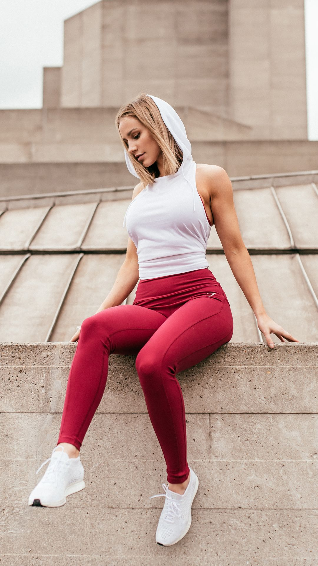 52365c0707a06f Essential gym wear. Gymshark Athlete, Robin Gallant styling the Hooded Vest  in White and Aspire Leggings in Beet.