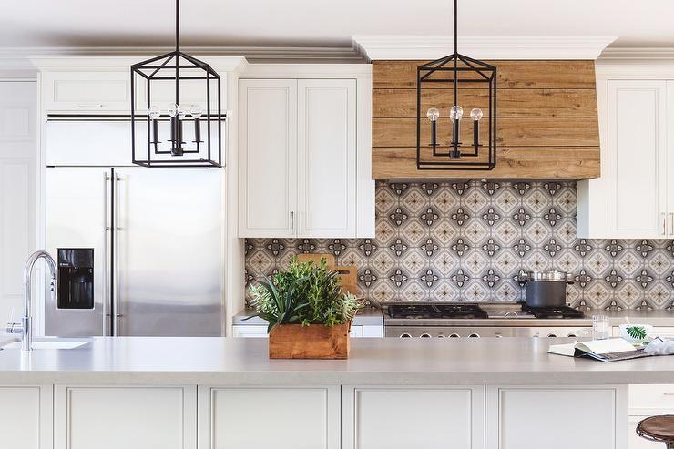 Gold And Gray Mosaic Backsplash And Rustic Wood Plank Kitchen Hood