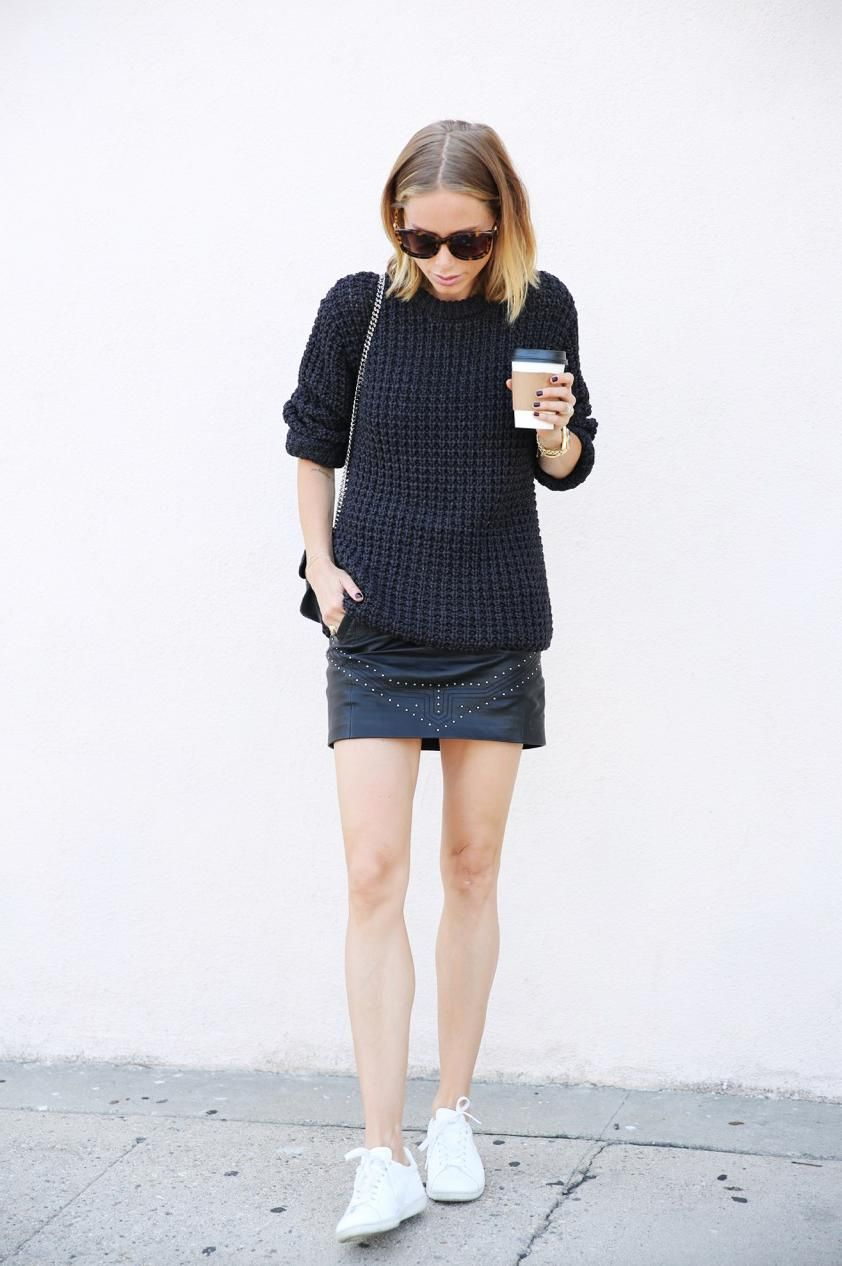 Danish Bloggers to Follow For Copenhagen Fashion Week - Anine Bing of fashion blog 'Anine's World', wearing a chunky sweater, black leather mini skirt and clean white sneakers