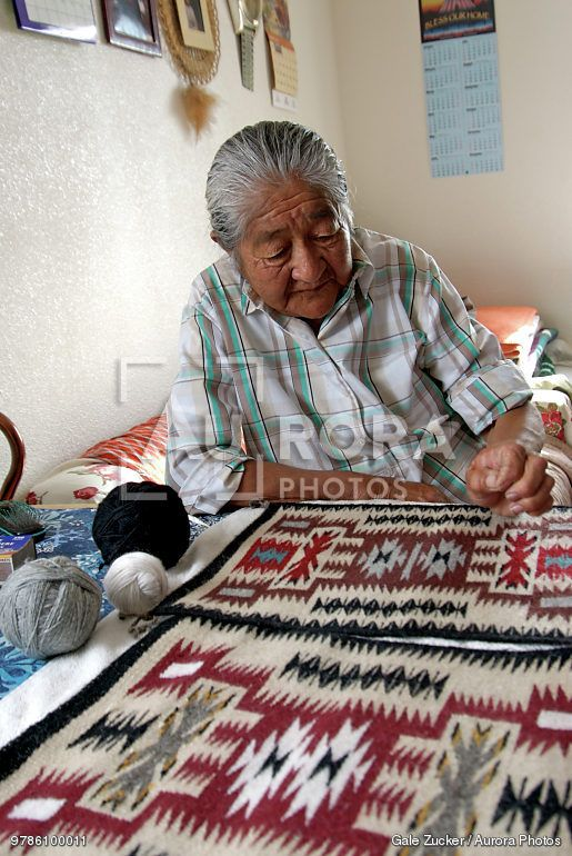 Rena Yazzie An Elderly Navajo Weaver Shows Traditional Symbols In