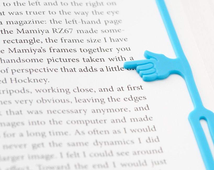 Pointing finger bookmark!! Perfect so I don't lose the line I'm on!!