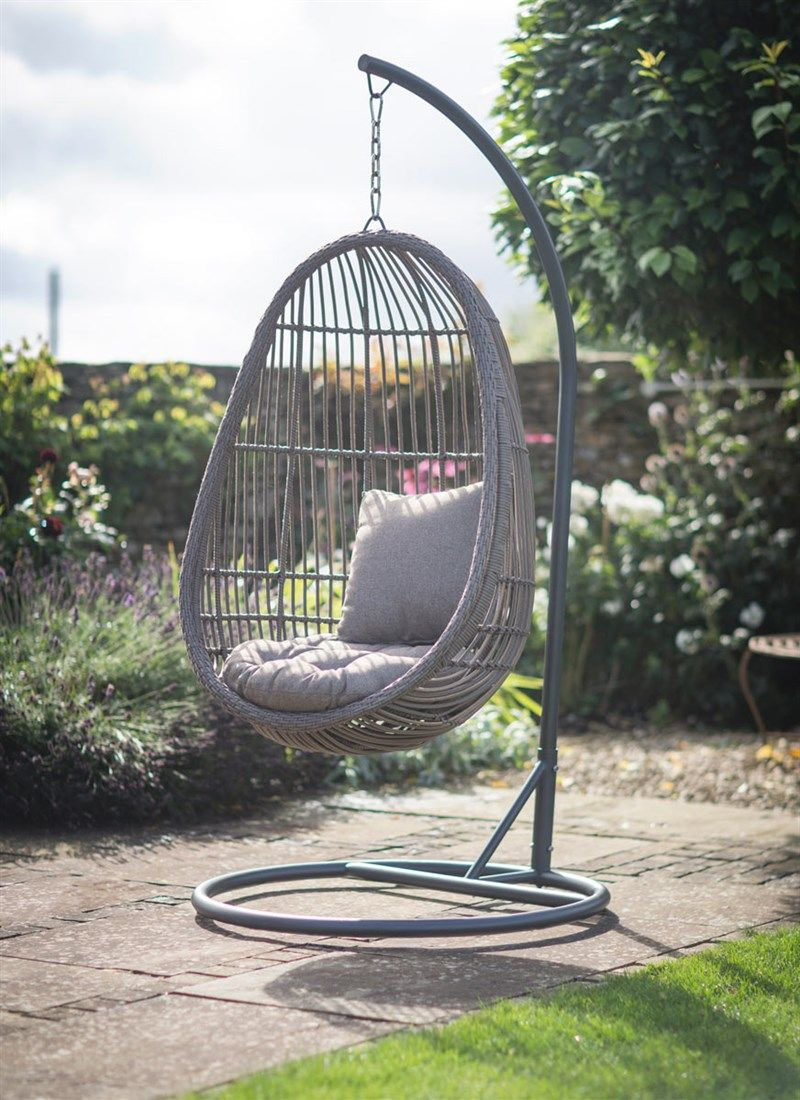 Our All Weather Rattan Hanging Nest Chair Comes With Its Own Stand,  Allowing You