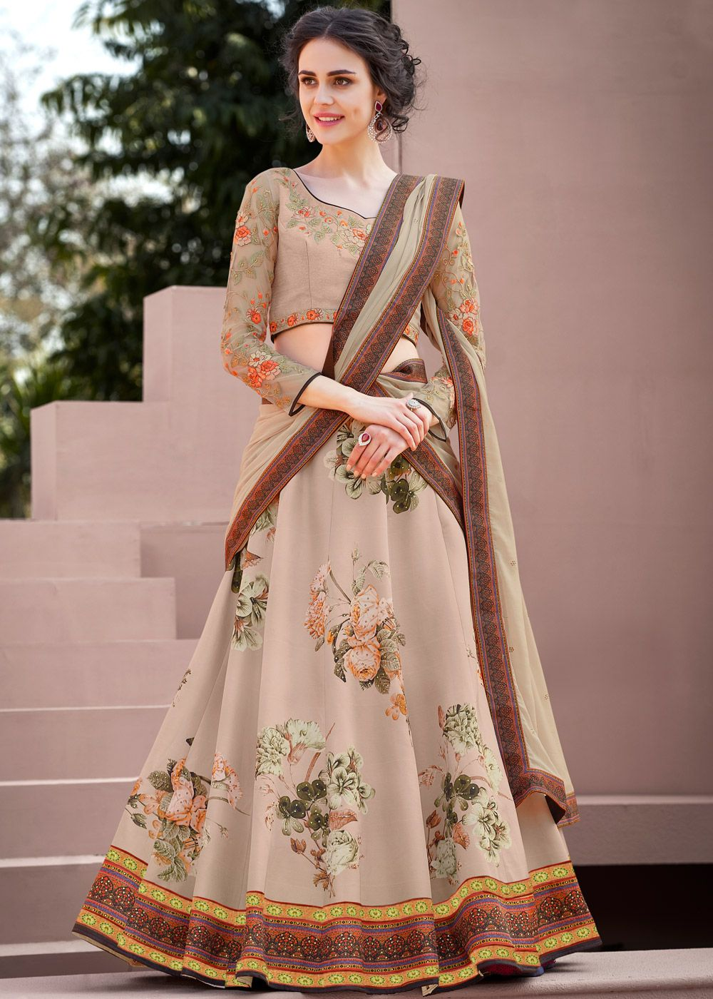 0617e5f113 Beige coloured satin silk lehenga choli with floral printing all over  enhanced by stunning stone work. As shown it comes with a satin silk blouse  with ...
