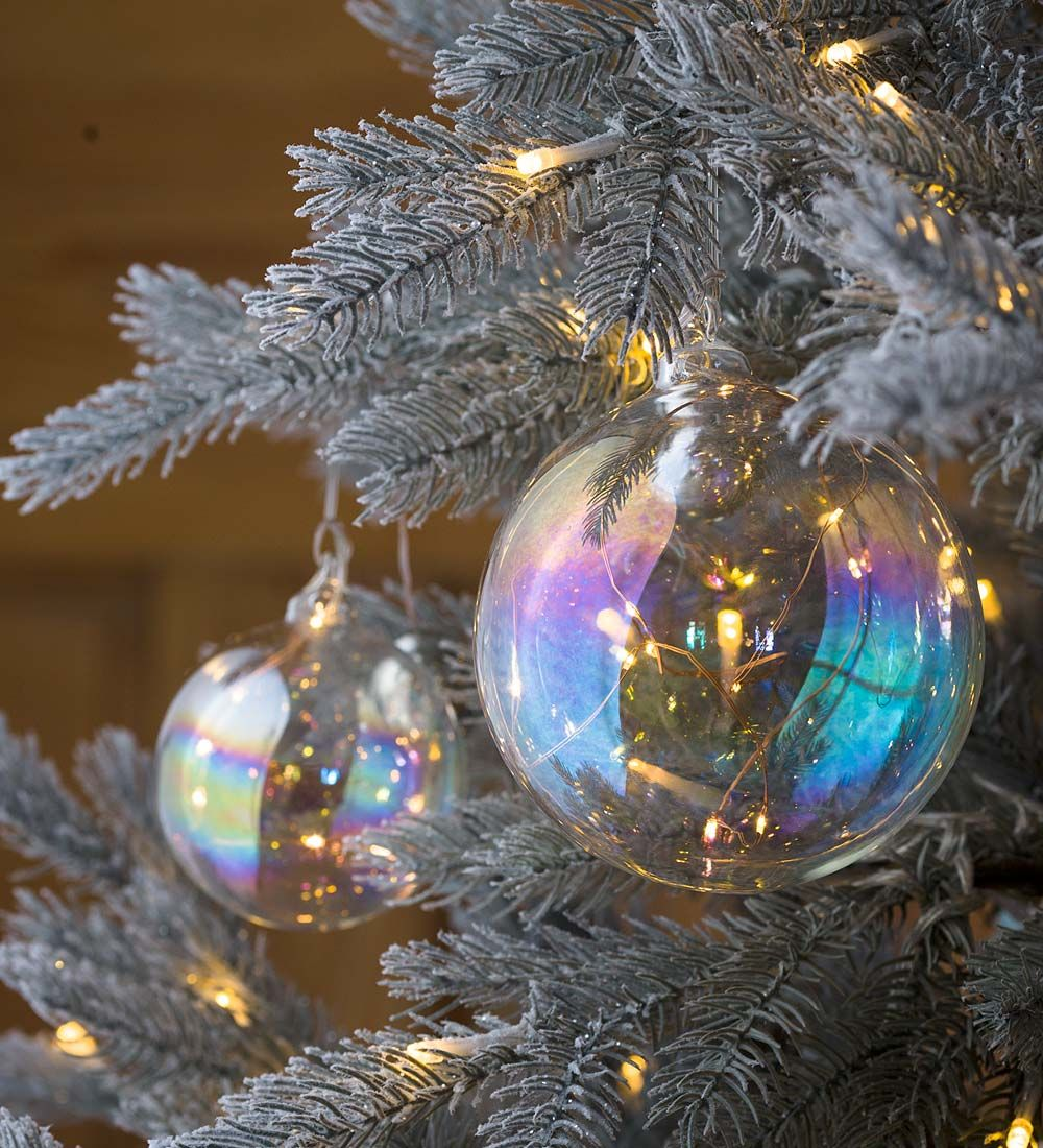 Our Lighted Iridescent Glass Ornament Has Warm White Lights Inside For A Wonderf Christmas Ornaments Christmas Decorations Ornaments Christmas Tree Decorations