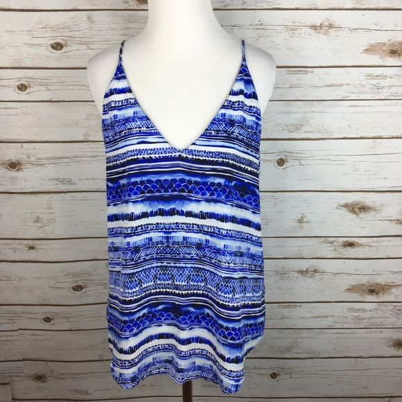 "[Rory Beca] Silk Stripe Abstract Tank Boho Goddess Beautiful silk patterned top by luxury label Rory Beca. V neck. Adjustable spaghetti straps. Relaxed fit. Looks great with white jeans!   Fabric: 100% Silk  Bust: 19"" Length: 24"" Condition: EUC. No flaws.  No Trades! Rory Beca Tops Tank Tops"