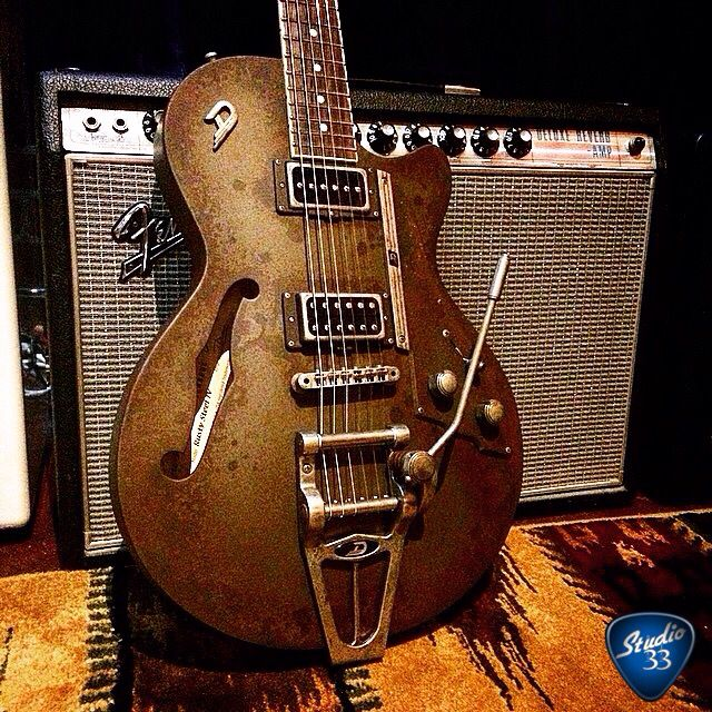 """This Duesenberg looks like it is metal, but it is wood with """"rust"""" paint. What do you think? #Duesenberg #guitar Learn to play guitar online at www.Studio33GuitarLessons.com"""