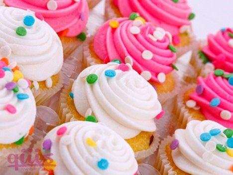 Cup Cakes con decoración de glaseado y confitería.