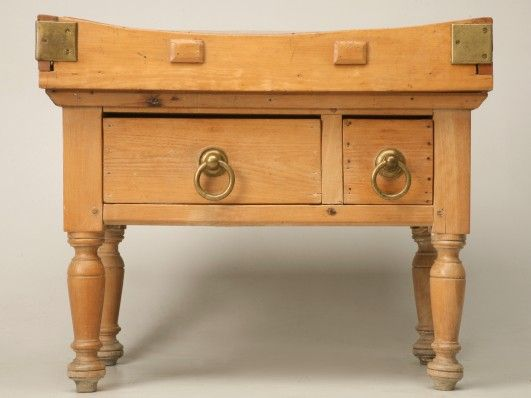 Vintage butcher block made from maple with the original solid brass hardware, dovetailed top and wooden-peg constructed legs. This piece has been in the owner's personal collection for 35 years.