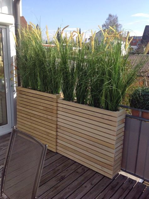 Narrow, slatted wooden containers. Despite the depth of these, I doubt that plants would thrive in such narrow planters.