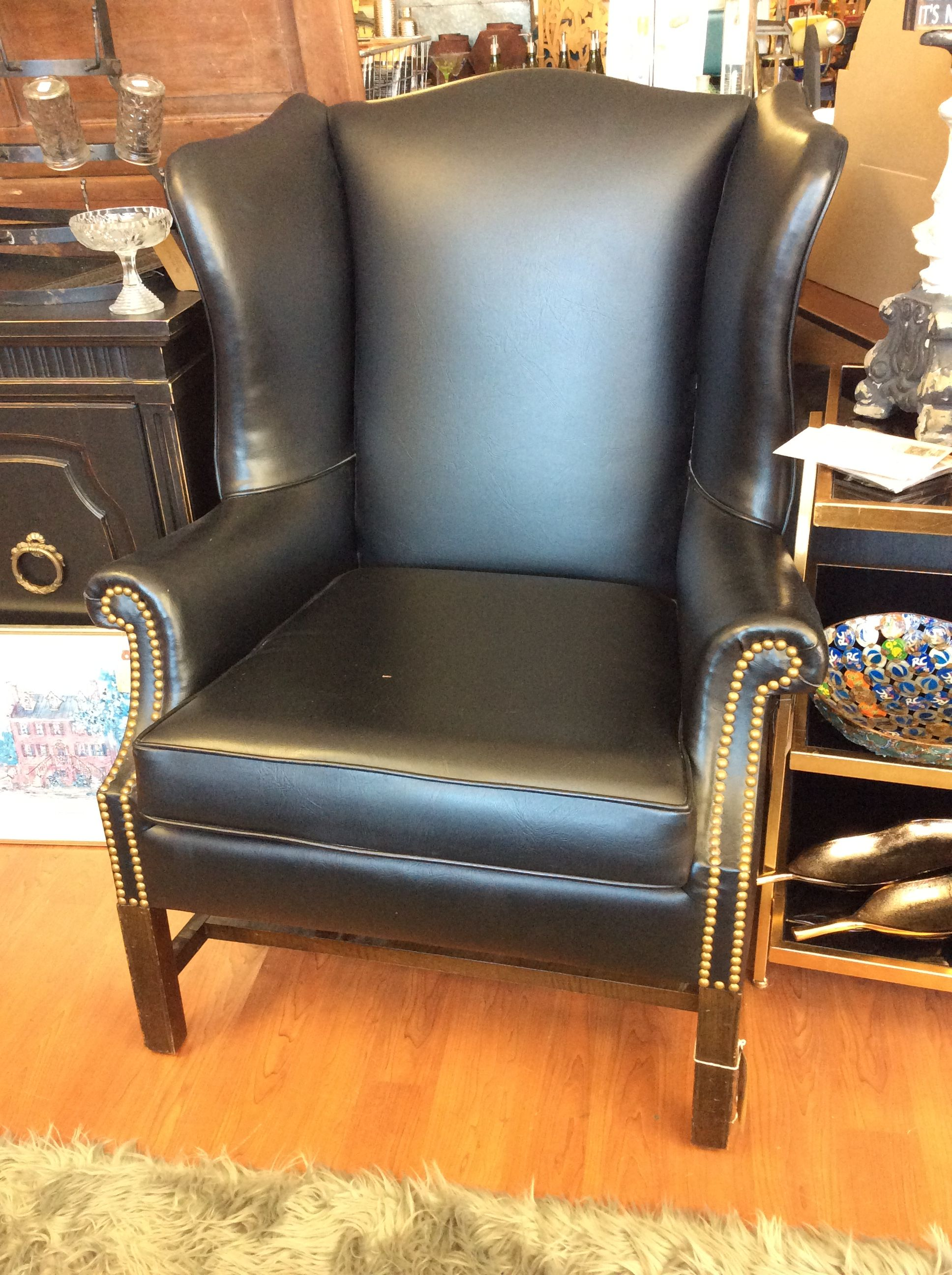 Beautiful black leather chair with gold metal