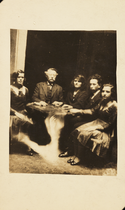 dandelionghost:    bloodmilk:    planchette:    sideshoweliza:    Group gathered at a seance. c. 1920.  Photo by William Hope (1863-1933)