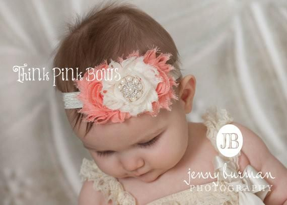 This beautiful headband features three shabby chic flowers on an elastic headband. It is topped with a luxurious eye catching pearl and rhinestone center. The flowers are felt backed for comfort. Simple and yet elegant, sure to be a real head turner!! Pair it with one of our adorable lace petti rompers for a complete look. Headband as pictured in coral and ivory.
