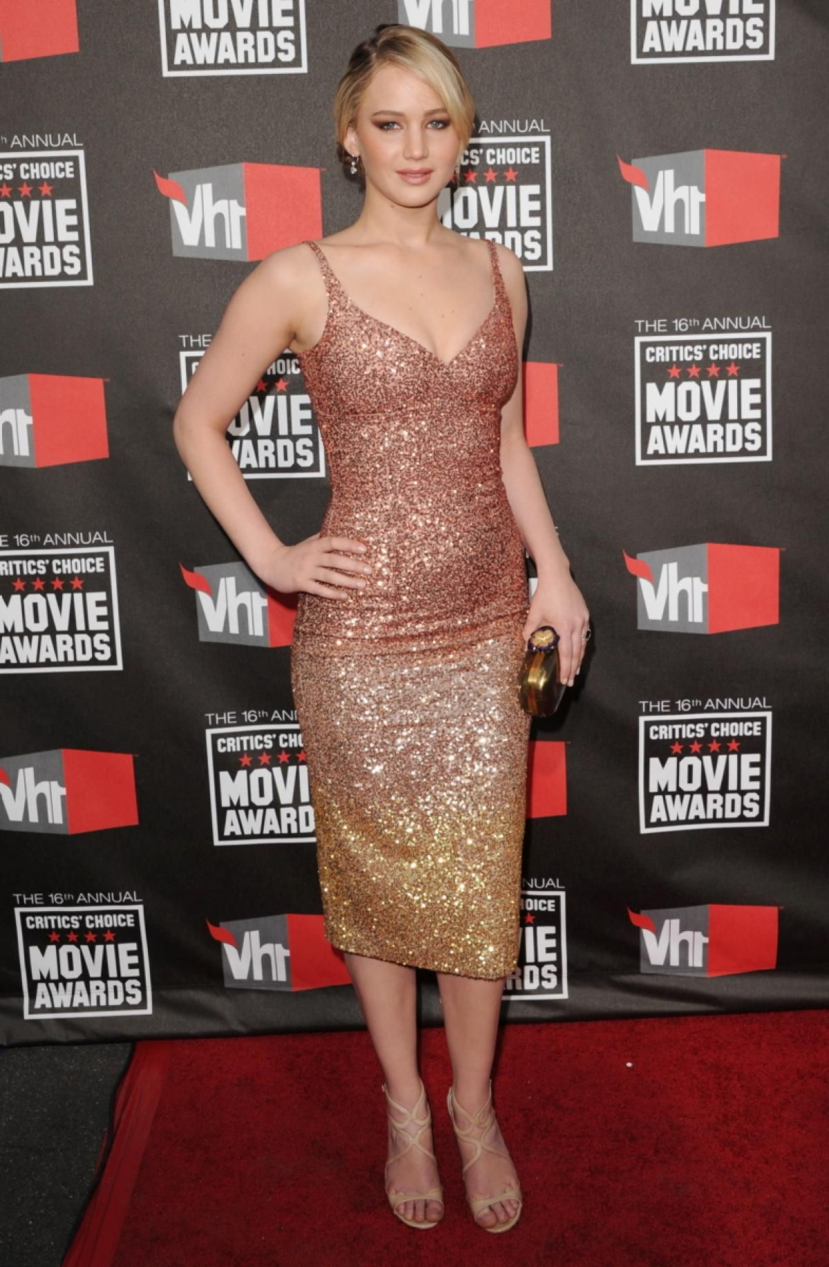 Jennifer Lawrence solidified her status as Hollywood golden girl when she arrived at the 2011 Critics' Choice Movie Awards wearing a stunning ombre L'Wren Scott dress that fit her like a glove.