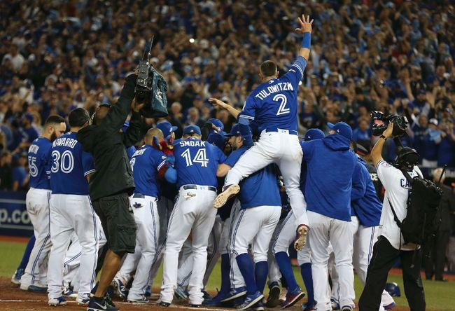 The Toronto Blue Jays Celebrate Their Extra Innings Walk Off Wild Card Game Victory Over The B Toronto Blue Jays Blue Jays Baseball Basketball Uniforms Design