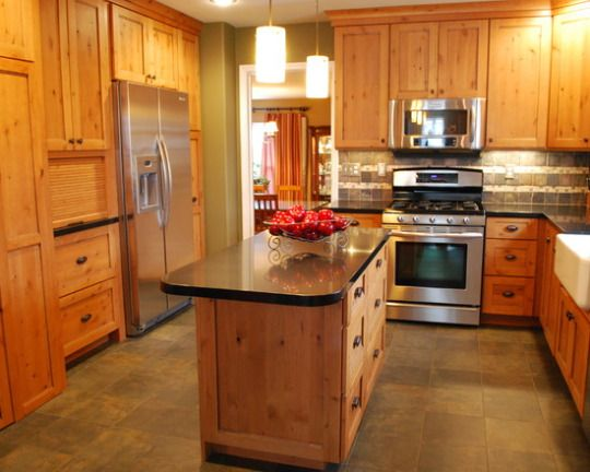Knotty pine kitchen with apron sink, granite counter tops, tile ...