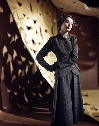 Betty Threatt in black moire suit, photo by Genevieve Naylor, 1949