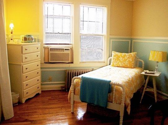 Sweet yellow, blue, and white bedroom with spool bed.