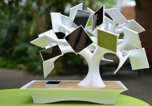 "The Electree+, A Solar-Powered, Induction Charging Bonsai Tree ""The electree+ boasts a 14,000mAh internal battery, which when fully charged can fill an iPhone 5 up to and over nine times. It requires 36 hours in sunlight to build up a full charge, but it also only needs around 4 hours to build up enough juice to fully recharge your standard smartphone. Go Green With Solar, Visit www.GreenerDawn.com"