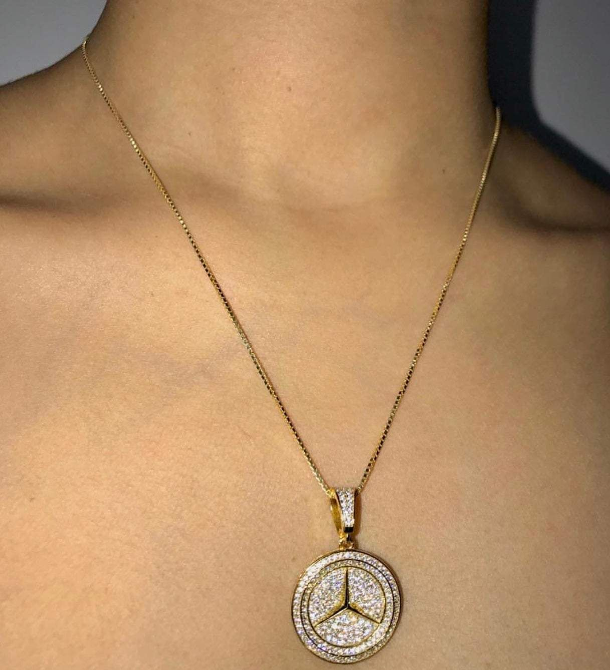 The pendant is made out gold filled and the necklace is