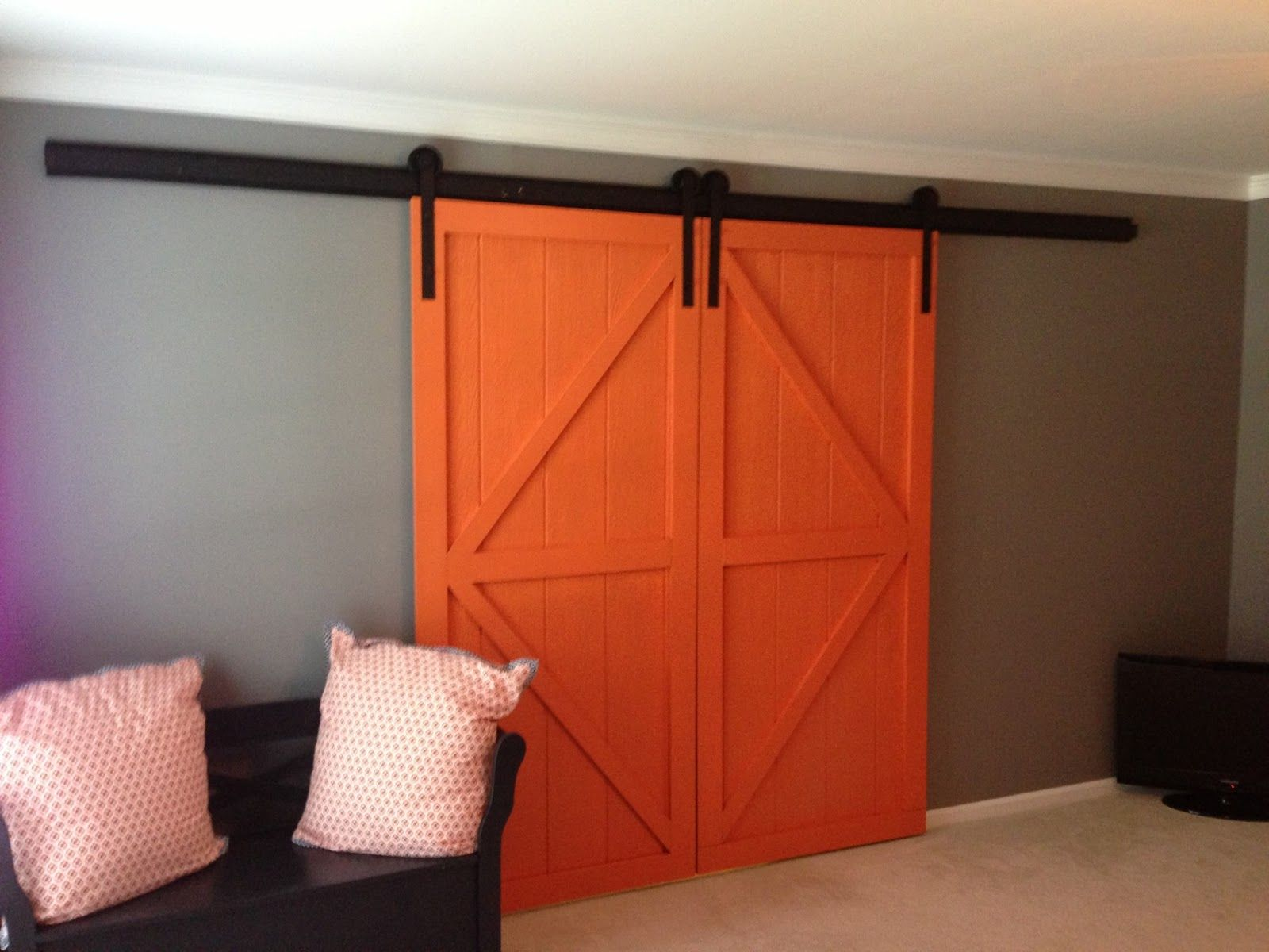 Trendy Enclosed Double Sliding Barn Door With Gray Wall Painted Feat Wooden Benches In Black As Decorate Midcentury Living Areas Furnishing Designs