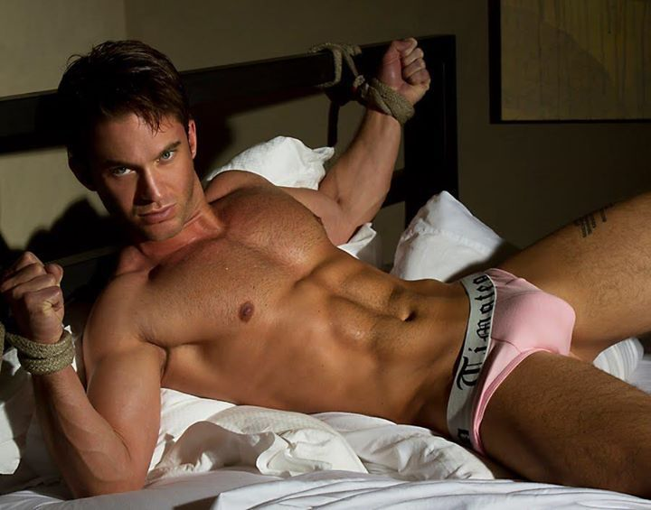 Sexy homosexual guys play on bed