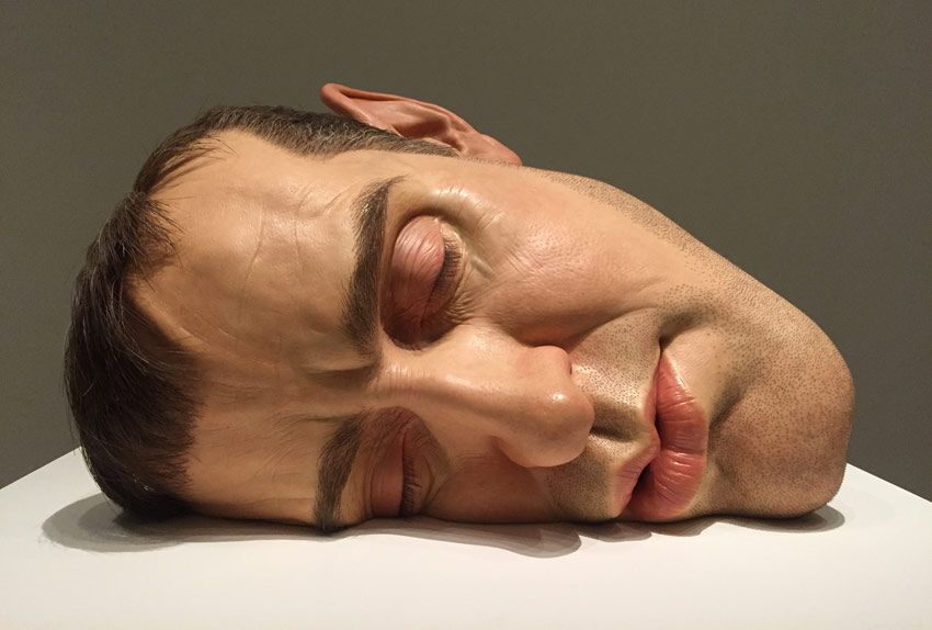 hyper realist sculpture titled mask ii by ron mueck at mfah