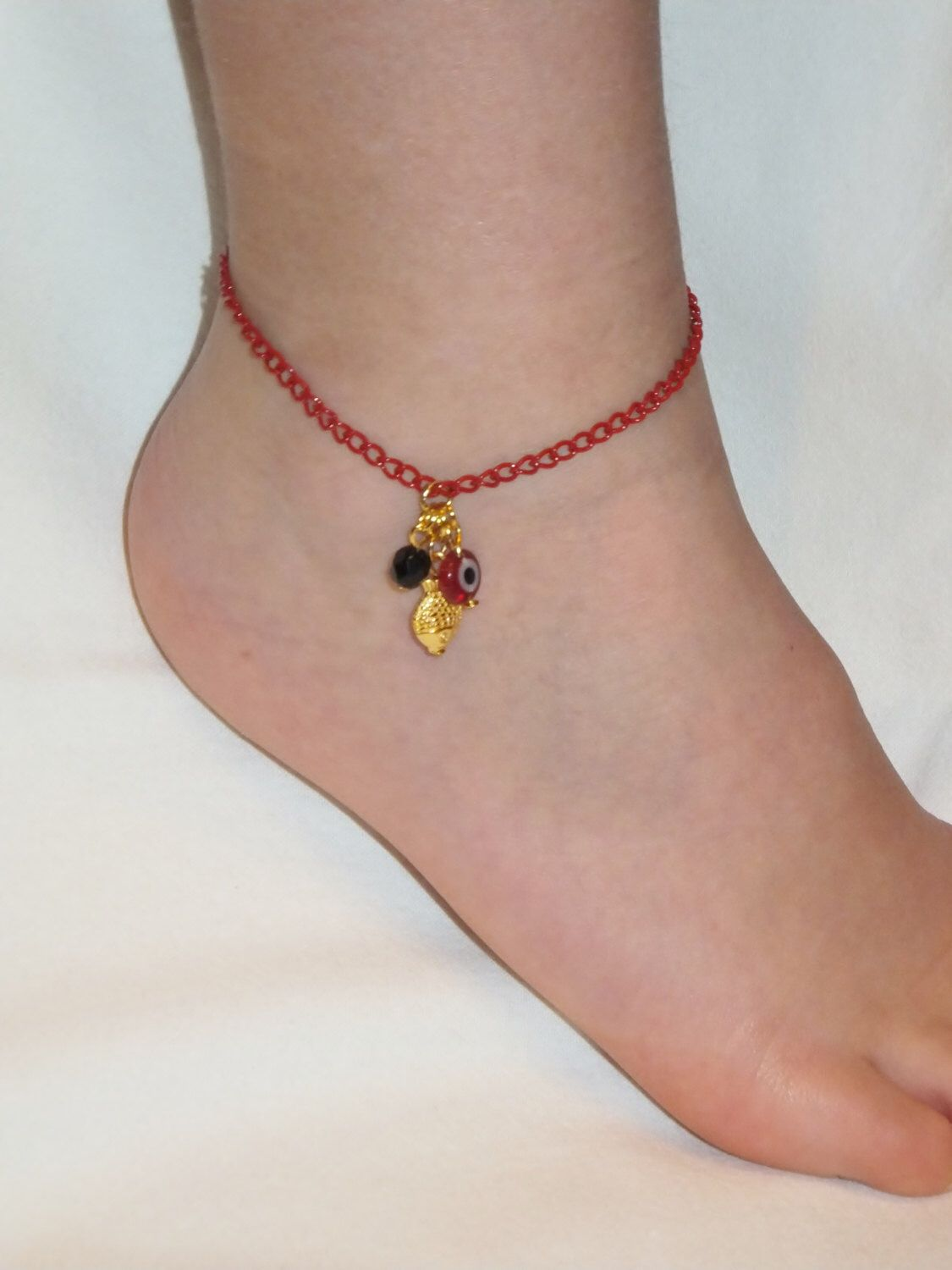 A personal favorite from my Etsy shop https://www.etsy.com/listing/179098917/red-evil-eyet-ankletfish-charm