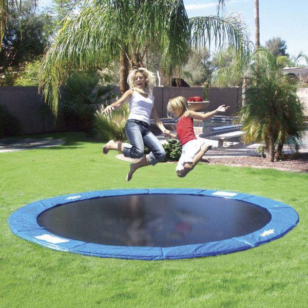 29 Amazing Backyards That Will Blow Your Kids Minds In Ground Trampoline Backyard Fun Backyard