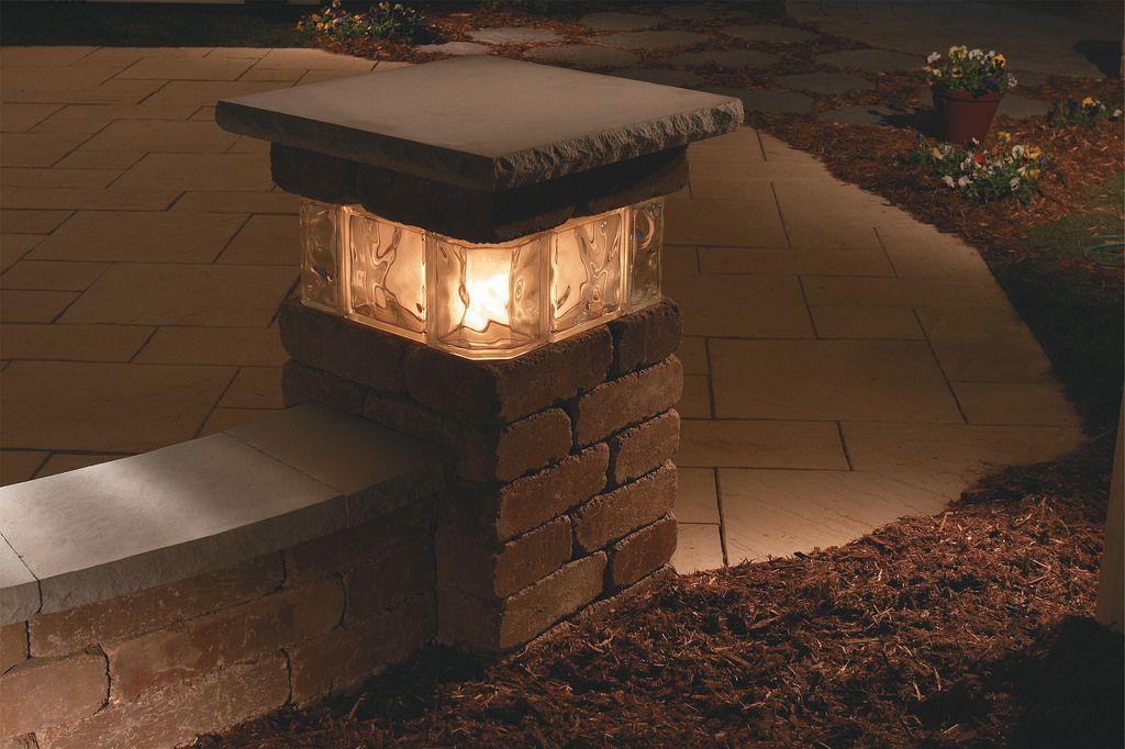 lit stone pillar hintergarten