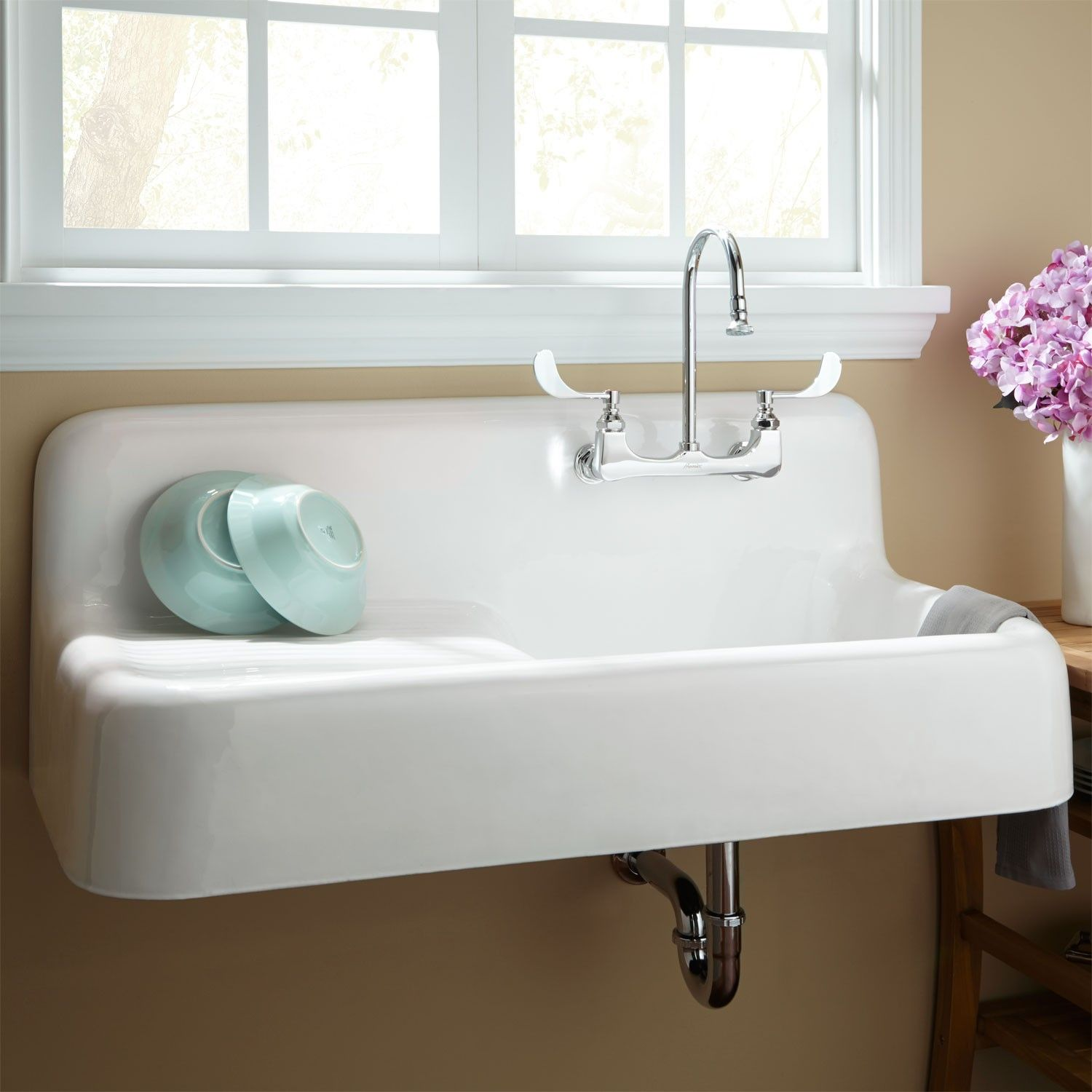 A vintage cast iron kitchen sink with drainboard famous in