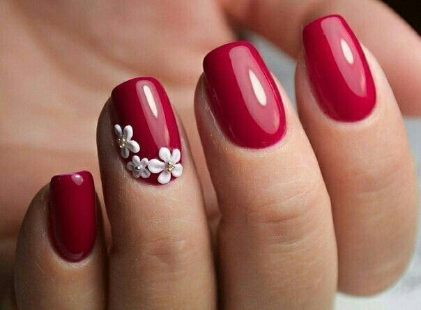 Red nails with white flowers