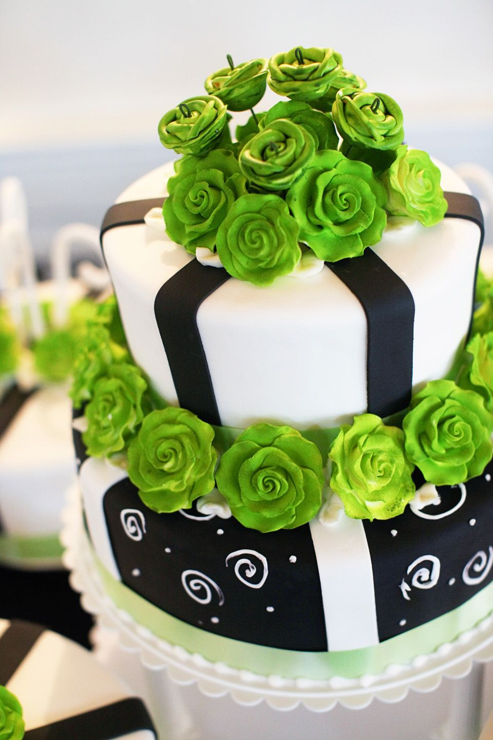 Intricate Lime Green Roses Made Of Icing Top A Two Tiered Black And White Wed