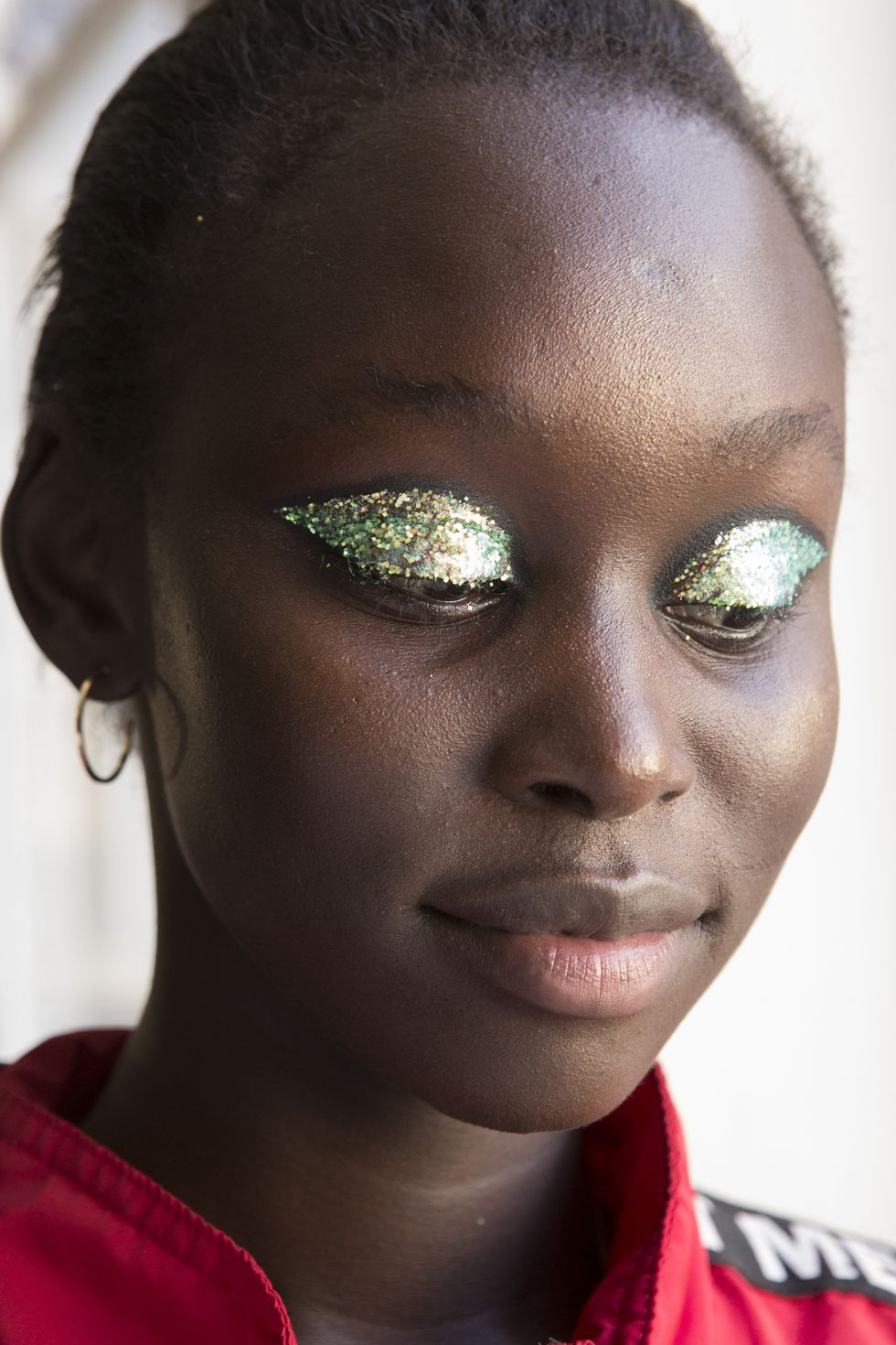 b1b111889a5 Ditch the black eyeliner and create a feline flick with festive glitter  Glitter Makeup Looks,