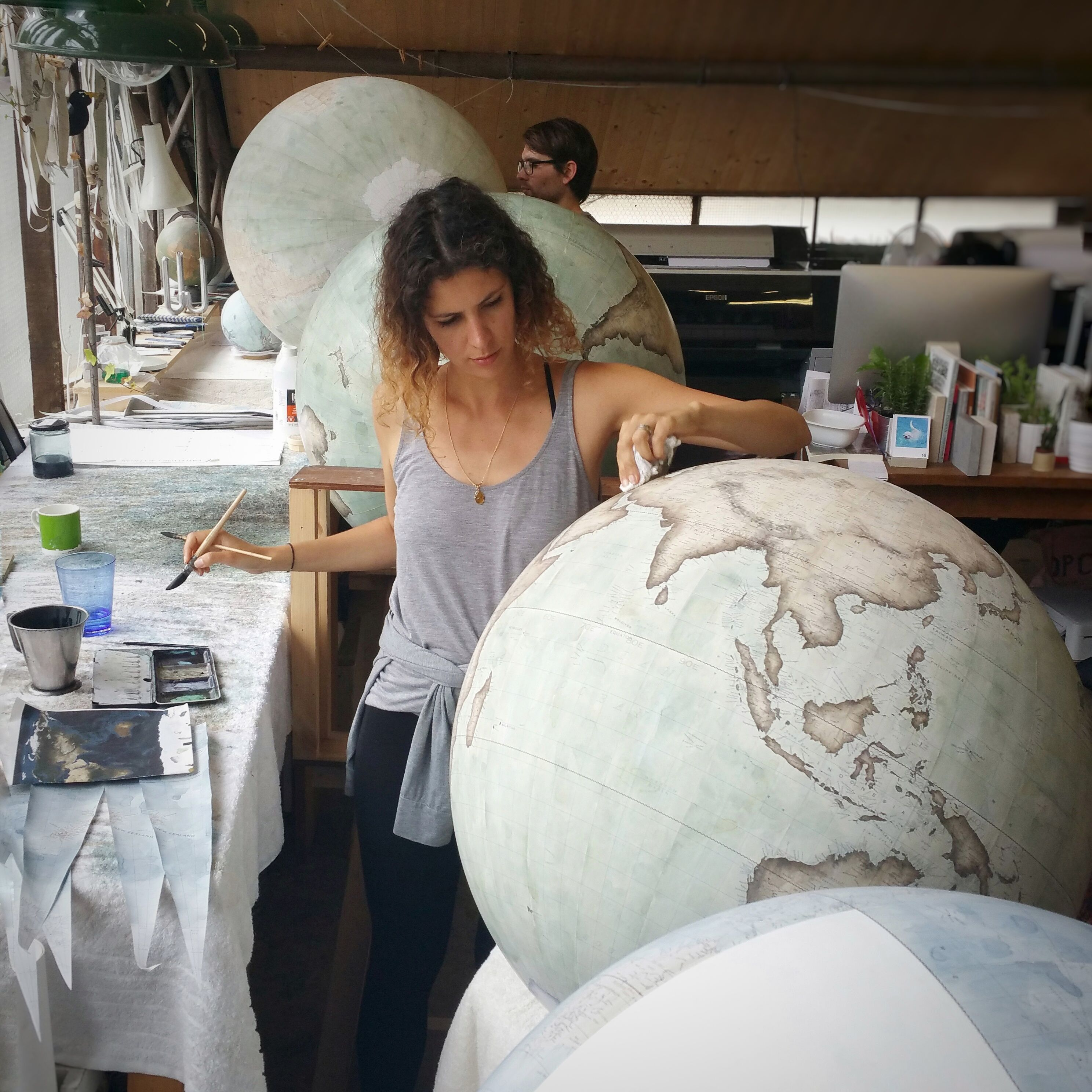 In the London globe-making studio with Bellerby & Co Globemakers. Handcrafted and hand painted world globes. Colour : Mint Green. Photo : Jade Fenster