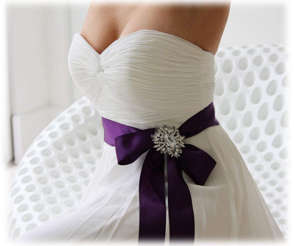 Wedding dress with purple bow