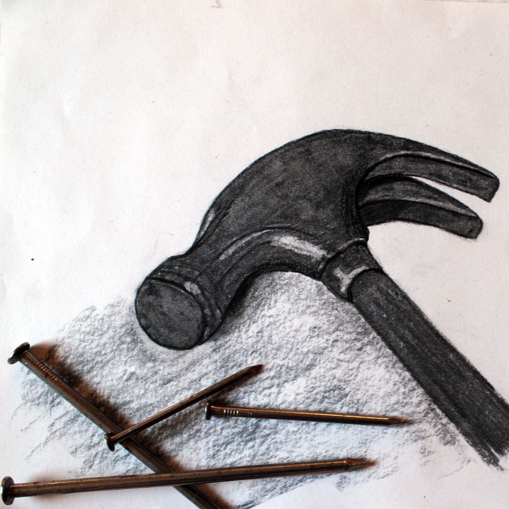hammer and nails drawing. charcoal drawing of hammer and nails
