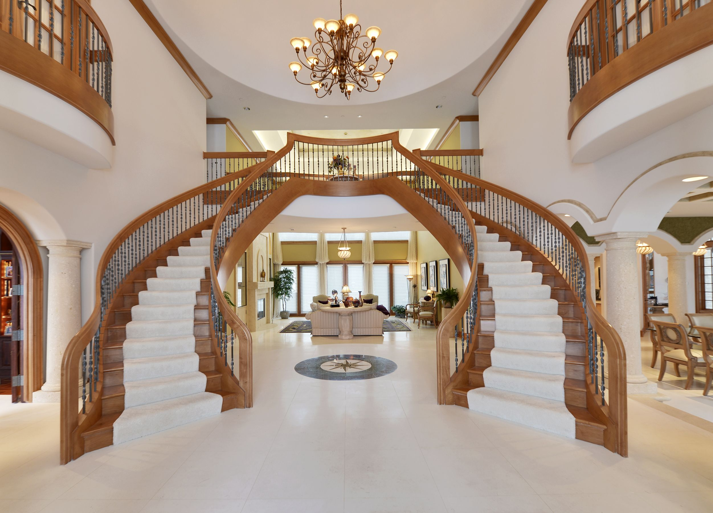 Dual staircase in grand foyer luxury homes pinterest for Mansion foyer designs