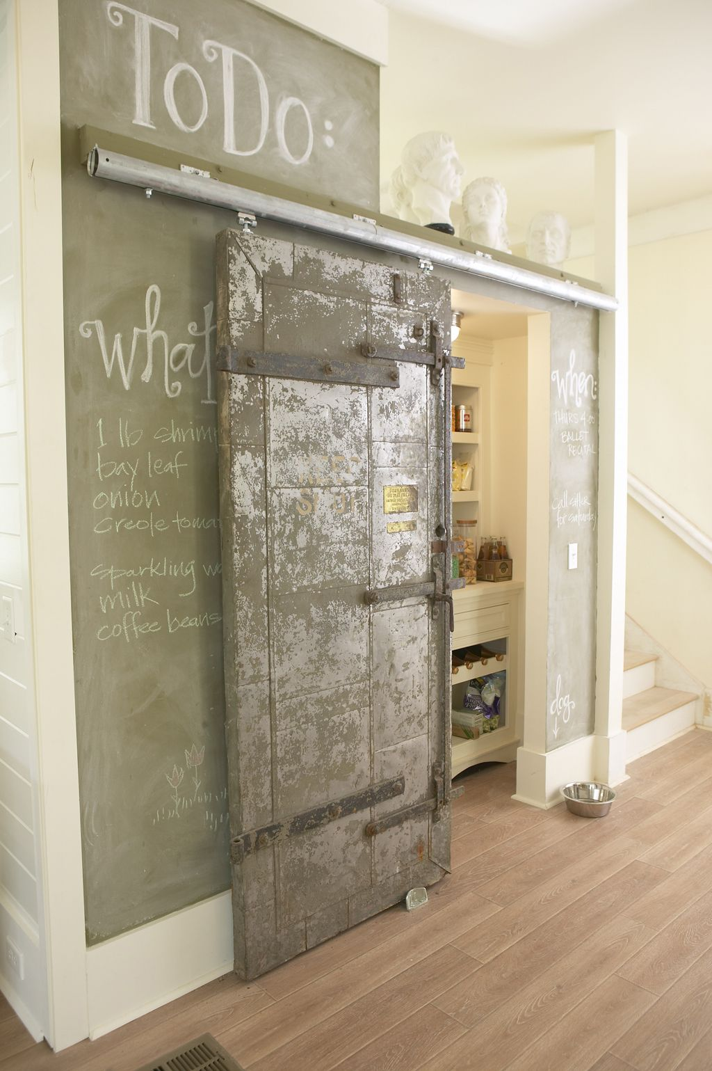A vintage sliding bank door helps conceal the pantry in this New Orleans home. & A vintage sliding bank door helps conceal the pantry in this New ...