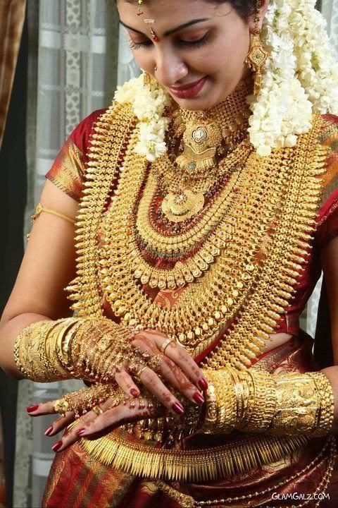 Kerala Bride Decked In Gold