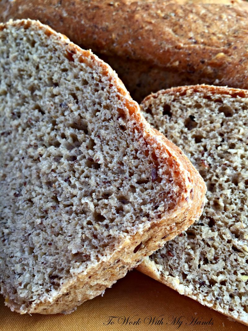 Hearty Oatmeal-Flax Bread is loaded with goodness: rich whole wheat, heart-healthy oatmeal and flax, healthy coconut oil fats, & immune-boosting raw honey.