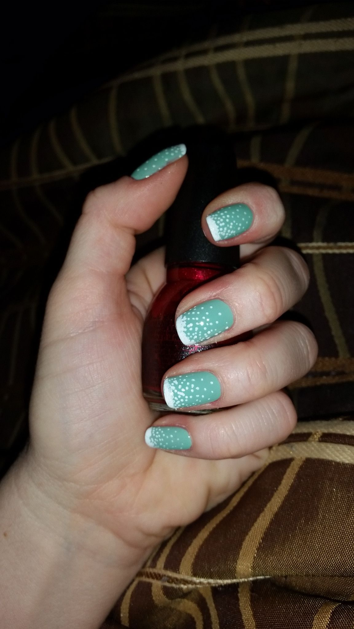 Matte mint nails with white dotted tips for a snowfall effect by user beckynickie on reddit.
