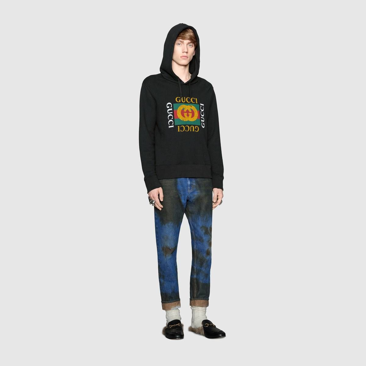 cac9cabff27 Shop the Oversize sweatshirt with Gucci logo by Gucci. Alessandro Michele  updates the Gucci vintage logo in an unexpected way