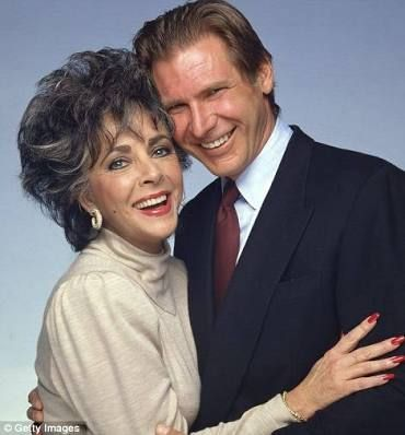 Elizabeth Taylor poses with Harrison Ford at the Paramount Pictures 75th Anniversary Party in Los Angeles, 1987