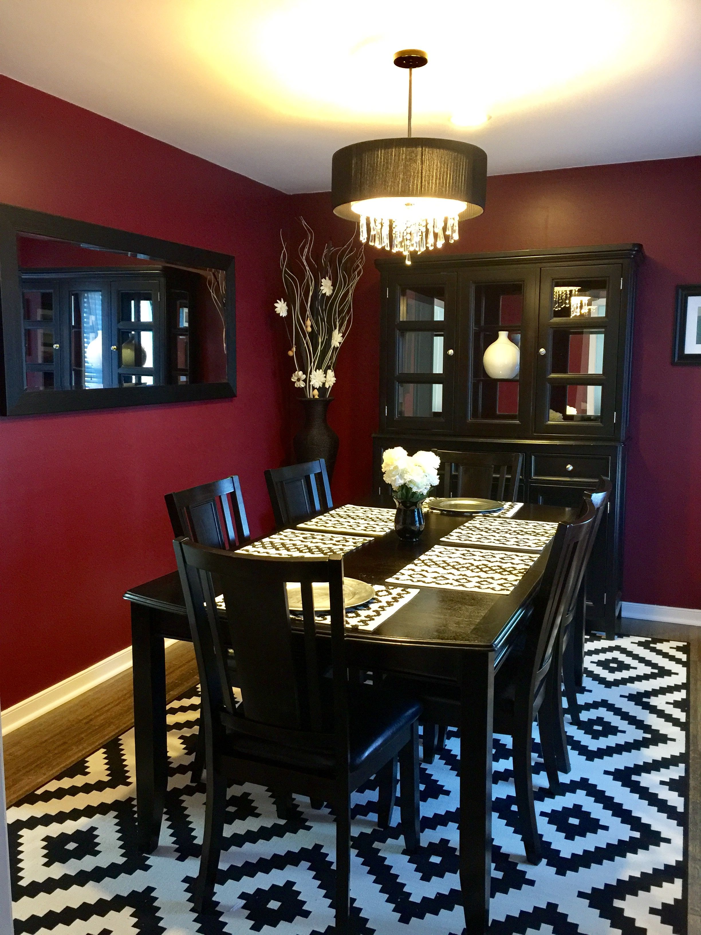 Black White Dining Room With A Pop Of Color On The Walls Beautiful Dining Room Decor Dining Room Table Decor Red Room Decor