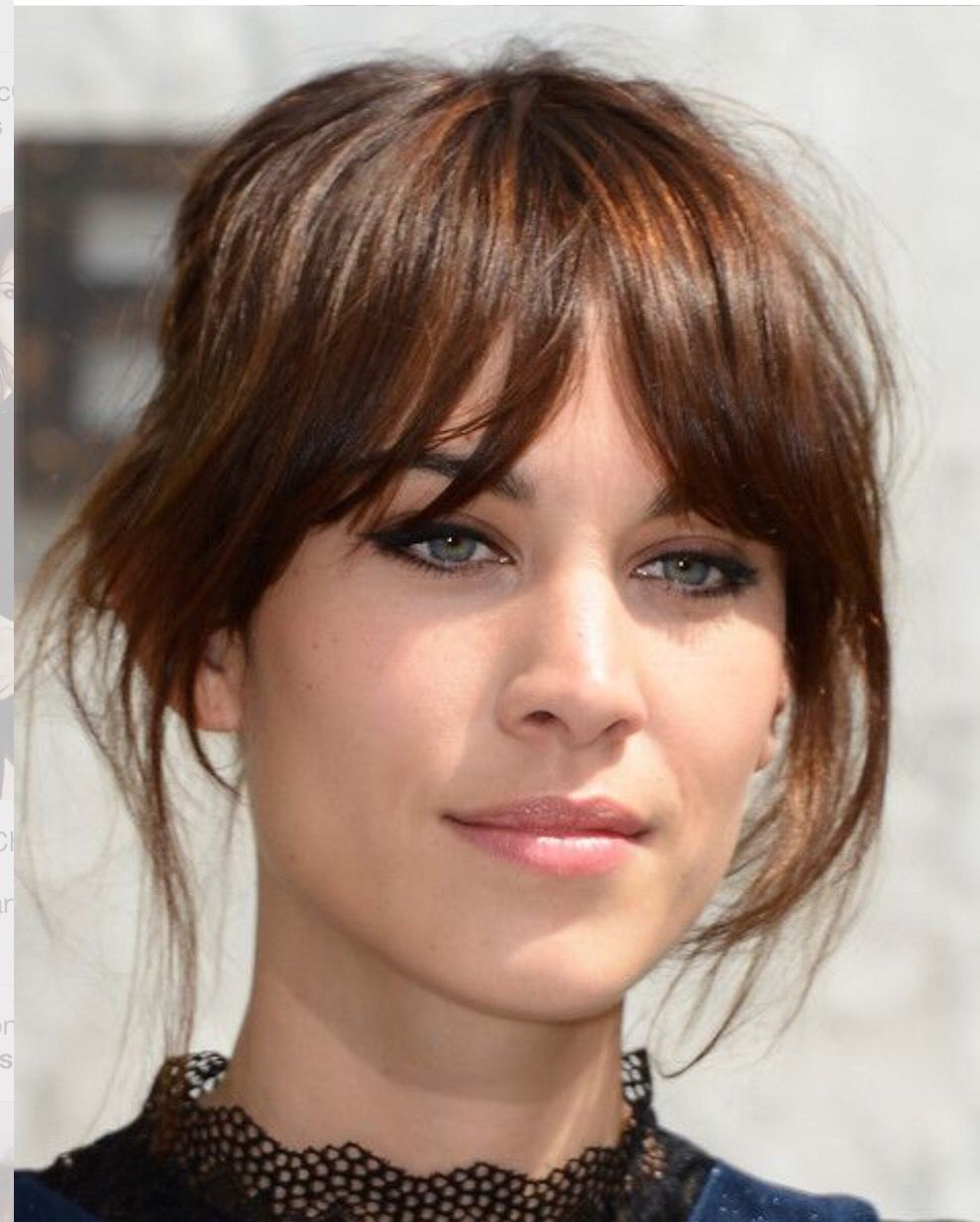 sparse whispy fringe, cut lash length and tapered to cheekbone