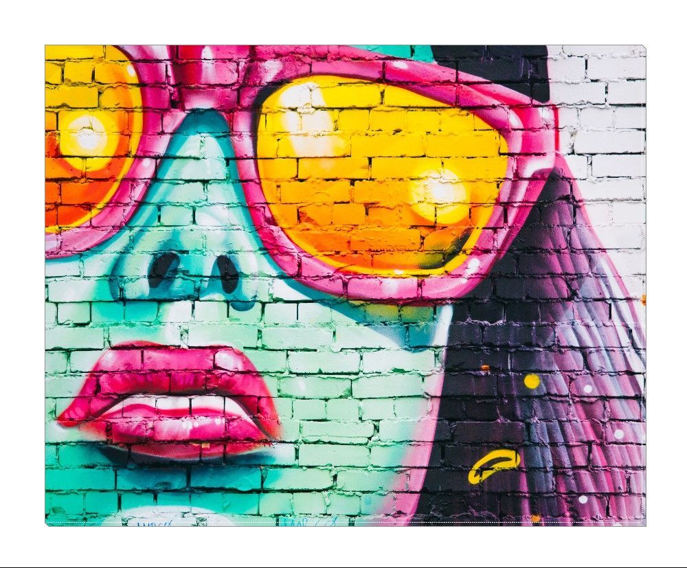 """Stunning graffiti art featuring a woman wearing fashionable sunglasses. Add beauty to any room with this gorgeous canvas wrapped art print. Features: • UV-coating, scratch resistant • 1.25"""" thick edge"""
